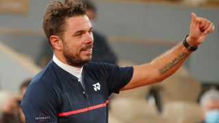 Switzerland's Stan Wawrinka celebrates after winning his French Open first round match against Britain's Andy Murray. Photo: Charles Platiau/Reuters