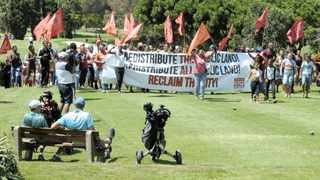 Reclaim the City takes over the Rondebosch Golf Course to protest against the City's failure to redistribute public land for the development of affordable housing. Picture: Tracey Adams / African News Agency (ANA)