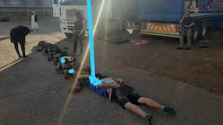 Ten people were arrested for allegedly being found in possession of a hijacked truck from which they were offloading cooking oil. Picture: SAPS