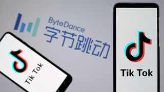 TikTok logos are seen on smartphones in front of displayed ByteDance logo in this illustration. File picture: IANS