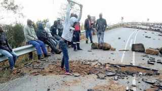 Pomeroy residents in northern KwaZulu-Natal, who are demanding water and electricity, dug up a portion of the tarred R33 this week.