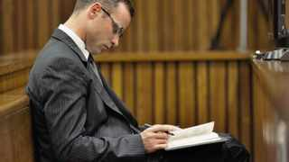 Oscar Pistorius sits in the dock during court proceedings on Tuesday, March 18, 2014. Picture: MARCO LONGARI
