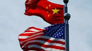 Chinese and US flags flutter in the breeze in Shanghai, China. File picture: Aly Song/Reuters
