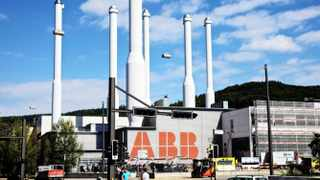 The logo of ABB AG sits on display outside the company's manufacturing plant in Baden, Switzerland, on Tuesday, Aug. 30, 2011. ABB AG is the world's largest builder of electricity grids. Photographer: Gianluca Colla/Bloomberg