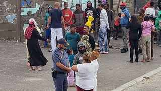 Philippi Police Station Station Commander Colonel Adriaan Saulse engages with residents at Agulhas Court Hanover Park during an imbizo after a four year old girl was shot on March 25. Picture: Supplied