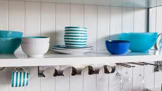 You can provide an airy feel to the open shelves by painting them with colours that match with the countertops. Picture: John Beans/Flickr.com