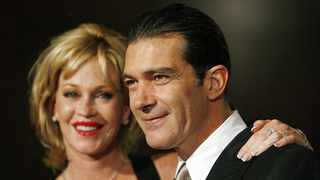 Actor Antonio Banderas and his wife Melanie Griffith pose at the 21st annual Imagen awards in Beverly Hills August 18, 2006. The Imagen Awards were established in 1985 to encourage and recognize the positive portrayal of Latinos in the entertainment industry. REUTERS/Mario Anzuoni (UNITED STATES)