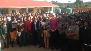 Author Mignonne Breier with today's teachers and learners at the school where her parents once taught.