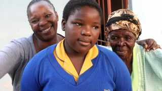Durban 05012015 Kimberly Dlamini (16) from Umlazi. with her mother, Nompumelelo and grandmother, Mpathi is getting her name. Picture:Jacques Naude