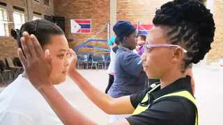 ATTACK: Mantsadi Sepheka, a Stay Safe member, demonstrates a hit to one of the participants at a workshop in Villiersdorp. Picture: Margaret Neethling