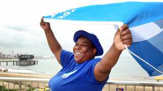 Beach employee and Durban's social media hero Edith Mkhize celebrates the announcement of Blue Flag status for five of the city's main beaches.
