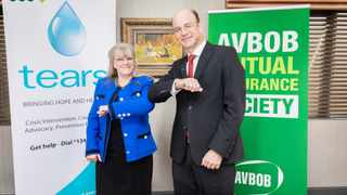 Mara Glennie, founder and director of the TEARS Foundation and Carl van der Riet, AVBOB CEO, elbow bump on the funeral service and insurance group's branded sponsorship agreement of TEARS' free USSD helpline (*134*7355#)