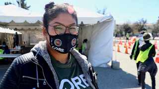 Gladis Castro at a vaccination site in Los Angeles. Picture: Chris Jaymes/CORE