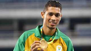 Wayde van Niekerk poses with the gold during the 400m medal ceremony at the 2016 Rio Olympics. Picture: Leonhard Foeger/Reuters