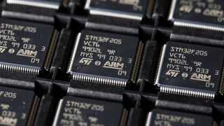 STMicroelectronics STM32F205 integrated circuit microchips designed by ARM Ltd. Picture: Bloomberg/Chris Ratcliffe