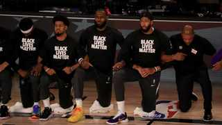 LeBron James and the Los Angeles Lakers wore Black Lives Matter shirts and took a knee following the death of George Floyd. Picture: Mike Ehrmann/Getty Images via Reuters