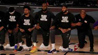 LeBron James and Anthony Davis of the Los Angeles Lakers were among the NBA players who knelt during the US national anthem in solidarity with the Black Lives Matter movement. Picture: Mike Ehrmann/Pool Photo via AP