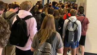 A photo taken by a student at North Paulding High School in Dallas, Georgia, shows that students continue to crowd hallways while fewer than half wear masks. Picture: AP