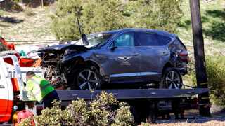 The damaged car of Tiger Woods is towed away after he was involved in a car crash, near Los Angeles, California. Photo: Mario Anzuoni/AFP