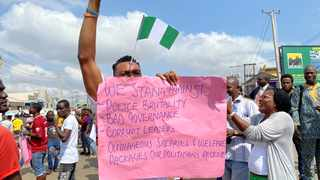 A demonstrator carries a banner during a protest demanding police reform in Lagos, Nigeria. Picture: Seun Sanni/Reuters