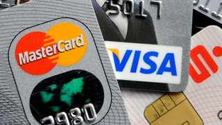 South African's focused on seeing that their credit cards were in good standing during the Covid-19 crisis by making timely payments rather than resorting to personal loans, as they shopped more online and used their cards to settle other debts, according to a new study by TransUnion. Picture: Martin Meissner, AP.