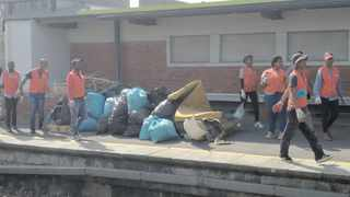 Volunteers gather up rubbish collected at Athlone station during a clean-up. Supplied