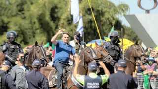 Brazilian President Jair Bolsonaro greets supporters in Brasilia. Experts believe he is trying to provoke a crisis in order to justify military intervention, which is his only hope of staying in power given his diminishing popularity, says the writer. Picture: Joedson Alves/EPA-EFE