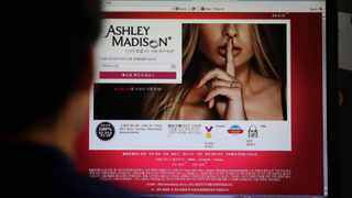 Ashley Madison's Korean website is shown on a computer screen. Hackers claim to have leaked a massive database of users from Ashley Madison. Picture: Lee Jin-man