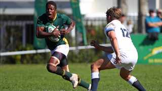 FILE - Muzilikazi Manyike of SA Schools evades a challenge from England U18's Joshua Hallett during their Aon U18 International Series rugby match at SACS School in Cape Town in 2018. Photo: Chris Ricco/BackpagePix
