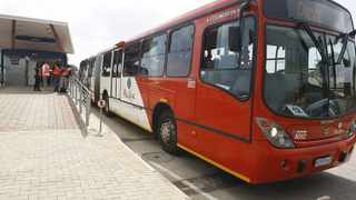 A Rea Vaya bus pulling out at its Orlando bus stop in Soweto, Joburg. Photo: Leon Nicholas.