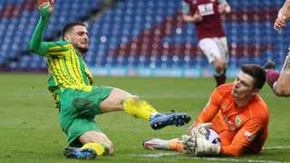 West Bromwich Albion's Okay Yokuslu in action with Burnley's Nick Pope during the two clubs' Premier League clash at Turf Moor on Saturday. Photo: Clive Brunskill/Reuters