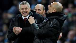 FILE - Manchester United and Manchester City managers Ole Gunnar Solskjaer and Pep Guardiola embrace following a Premier League match. Photo: Reuters