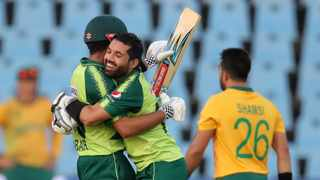 Pakistan's Babar Azam celebrates his century with Mohammad Rizwan during their T20 International against South Africa at SuperSport Park in Centurion on Wednesday. Photo: Samuel Shivambu/BackpagePix