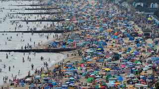 People enjoy Bournemouth Beach during an unusual heat wave in Bournemouth, England, in August 2020. Filepicture: Toby Melville/Reuters