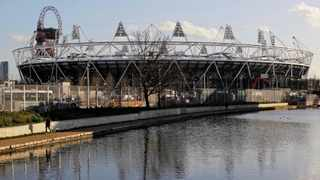 FILE - A jogger running on a canal path near the main Olympic Stadium in London. Photo: Sang Tan/AP