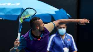 Australia's Nick Kyrgios throws his racket out of the court after smashing it during the Murray River Open men's singles tennis match against Croatia's Borna Coric in Melbourne. Photo: David Gray/AFP