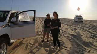 South African Marcelle Visser (right) is a driving safety marshal of Qatar's Dune Rider club. Picture: Karim Jaafar / AFP.