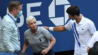Novak Djokovic and a tournament official tend to a line judge who was struck with a ball by Djokovic during his match against Pablo Carreno Busta at the US Open. Picture: Danielle Parhizkaran-USA TODAY Sports via Reuters