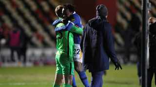 Percy Tau hugs his Brighton and Hove Albion teammate and goalkeeper Jason Steele following their FA Cup win over Newport County. Picture: @OfficialBHAFC on Twitter