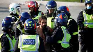 A man is detained during a demonstration in Trafalgar Square against the lockdown imposed by the government. Picture: Henry Nicholls/Reuters