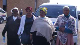 The mother of Gabisile Shabane Anna Shabane (second from right), her daughter Chantall Ngwenya (third from right) and other members of their family stand outside the Witbank Magistrate's Court in Mpumalanga. PHOTO: ANA Reporter