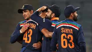 India's Prasidh Krishna celebrates with teammates after taking the wicket of England's Tom Curran and winning the match. Photo: Francis Mascarenhas/Reuters