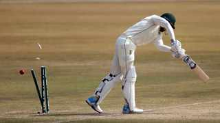 South Africa's Keshav Maharaj is bowled out by Pakistan's Hasan Ali (unseen) during the third day of the second Cricket Test match. Photo: EPA