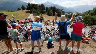 Spectators along the road applaud the riders during the 19th stage of the Tour de France cycling race between Saint Jean De Maurienne and Tignes. Unlike mostmajor sporting events, the 2020 race has yet to be called off because of the coronavirus. Thibault Camus, AP