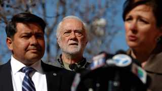 Alleged clergy abuse victims Ken Smolka, centre, and Manuel Vega, left, listen to Joelle Casteix, western regional director of Survivors Network of those Abused by Priests during a news conference outside the Cathedral of Our Lady of the Angels in Los Angeles.
