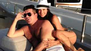 Simon Cowell and Lauren Silverman. Picture: AP