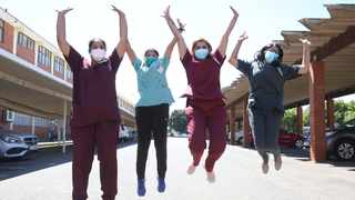 The four specialist physicians Leosha Baldeo, Thevaloshni Naidoo, Nerika Maharaj and Michelle Rajkaran who ran Prince Mshiyeni Memorial Hospital's Covid Unit jump for joy after being vaccinated on Thursday. Picture: Zanele Zulu/ANA