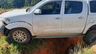 A bakkie used by suspects to steal Transnet diesel in Mpumalanga lost control and the vehicle landed in a ditch. Picture: The Hawks.