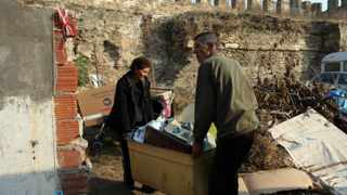 A couple move their belongings out of a soon-to-be demolished house near the Byzantine walls of Thessaloniki on 17 November, 2011. The municipality of Thessaloniki.