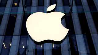 The Apple Inc logo is seen hanging at the entrance to the Apple store on 5th Avenue in Manhattan, New York, U.S. File picture: Reuters/Mike Segar